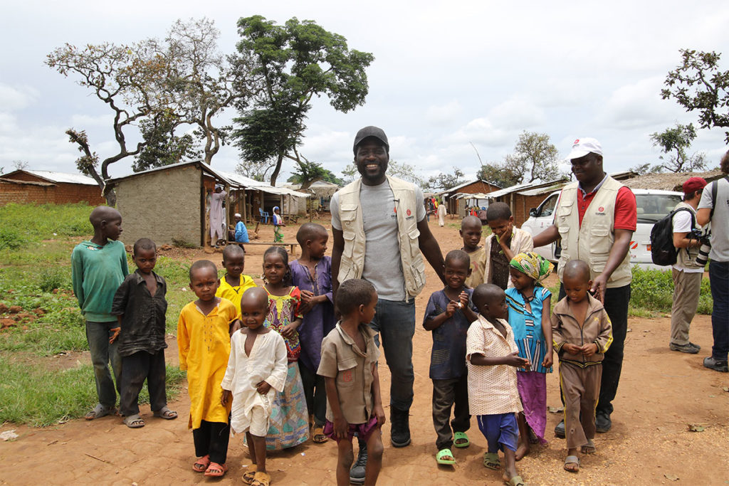 Donel Jack'sman with children in Gado camp